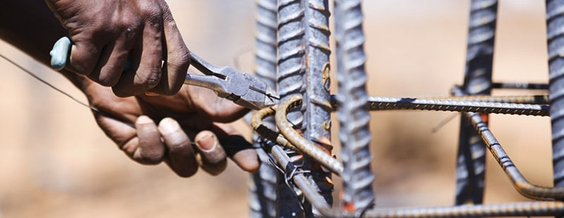 Close-up of man cutting wires